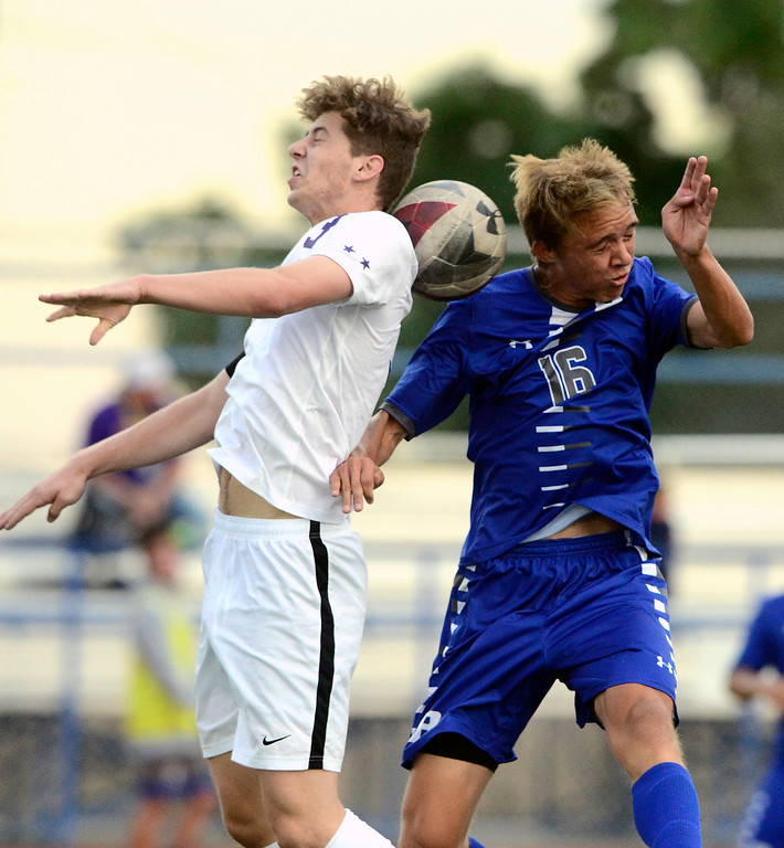 . BROOMFIELD, CO - SEPTEMBER 17 2018 Boulder High\'s Jesse Bacardi and  Broomfield High\'s Evan Stearns fight for a header during their soccer game in Broomfield on Monday September 17, 2018. More photos Bocopreps.com  (Photo by Paul Aiken/Staff Photographer)