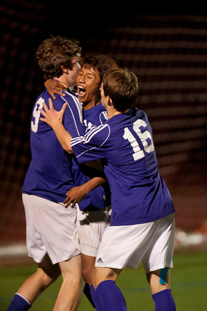 S0928SOCCER5<br /> Boulder's #12, Sushant Garung, center, is hugged by teammates, #19, Joshua Branum and #16, Matteo Wilczak after Garung scored a goal in the second half of their game against Fairview at Fairview High School on Thursday evening, September 27th, 2012.<br /> <br /> Photo by: Jonathan Castner
