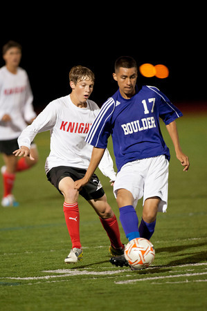 S0928SOCCER4<br /> Boulder's #17, Luis Castruita pulls the ball away from Fairview's #8, Connor Kerry during their game against Fairview at Fairview High School on Thursday evening, September 27th, 2012.<br /> <br /> Photo by: Jonathan Castner