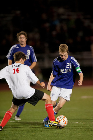 S0928SOCCER8<br /> Boulder's #21, Lake Brant and Fairview's #14, Zach Lokay battle for possesion of the ball during their game against Fairview at Fairview High School on Thursday evening, September 27th, 2012.<br /> <br /> Photo by: Jonathan Castner