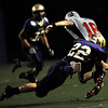 "Boulder's Travis Campbell, 22, takes down Loveland's Geoff Call, 18, during their game at Recht Field at Boulder High School on Friday September 9, 2011. <br /> FOR MORE PHOTOS FROM THE GAME GO TO  <a href=""http://WWW.DAILYCAMERA.COM"">http://WWW.DAILYCAMERA.COM</a><br /> Photo by Paul Aiken / The Camera / September 9 2011"