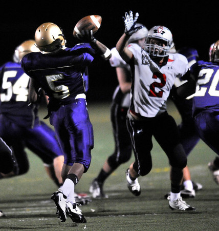 """Boulder's Demetrius Kennedy, 5, passes for a touchdown over Loveland's Ryan McCloughan, 2,  during their game at Recht Field at Boulder High School on Friday September 9, 2011. <br /> FOR MORE PHOTOS FROM THE GAME GO TO  <a href=""""http://WWW.DAILYCAMERA.COM"""">http://WWW.DAILYCAMERA.COM</a><br /> Photo by Paul Aiken / The Camera / September 9 2011"""