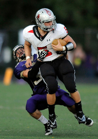 """Loveland;s Willie Dunkelman is wrapped up by Boulder's Ian Metzger, 37, during their game at Recht Field at Boulder High School on Friday September 9, 2011. <br /> FOR MORE PHOTOS FROM THE GAME GO TO  <a href=""""http://WWW.DAILYCAMERA.COM"""">http://WWW.DAILYCAMERA.COM</a><br /> Photo by Paul Aiken / The Camera / September 9 2011"""