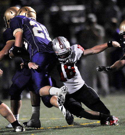 """Loveland's Geoff Call, 18, wraps up Boulder's Abel Brown, 20, during their game at Recht Field at Boulder High School on Friday September 9, 2011. <br /> FOR MORE PHOTOS FROM THE GAME GO TO  <a href=""""http://WWW.DAILYCAMERA.COM"""">http://WWW.DAILYCAMERA.COM</a><br /> Photo by Paul Aiken / The Camera / September 9 2011"""