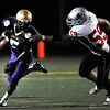 "Demetrius Kennedy, 5, escapes from Loveland's 59 Zach LeBaron, during their game at Recht Field at Boulder High School on Friday September 9, 2011. <br /> FOR MORE PHOTOS FROM THE GAME GO TO  <a href=""http://WWW.DAILYCAMERA.COM"">http://WWW.DAILYCAMERA.COM</a><br /> Photo by Paul Aiken / The Camera / September 9 2011"
