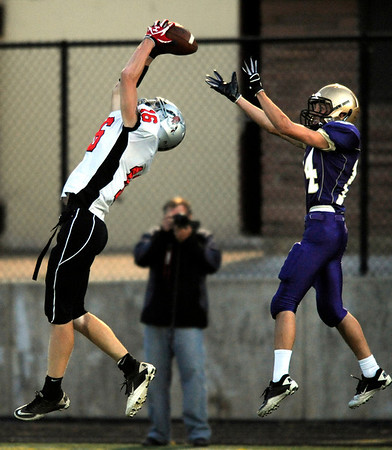 "Loveland's Kirk Shaw, 16, makes an interception in front of Boulder's Loic Guegan, 14, during their game at Recht Field at Boulder High School on Friday September 9, 2011. <br /> FOR MORE PHOTOS FROM THE GAME GO TO  <a href=""http://WWW.DAILYCAMERA.COM"">http://WWW.DAILYCAMERA.COM</a><br /> Photo by Paul Aiken / The Camera / September 9 2011"