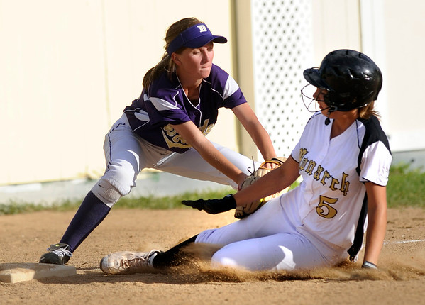 Boulder High's #10 Mia Webb tags out Monarch's #5 Kaitlyn Meska at 3rd during their game against Boulder on Monday at Boulder High School.<br /> Photo by Paul Aiken / The Camera