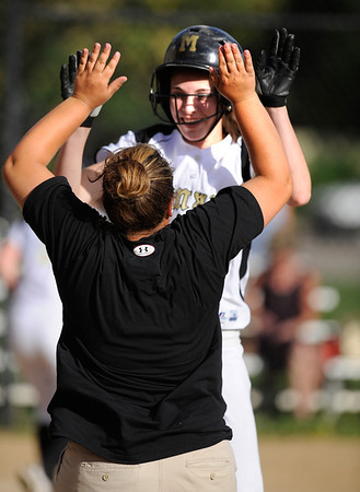 Monarch's #8 Kelly O'Flannigan is congratulated by coach Sara Solvacek after hitting a home run during their game on Monday at Boulder High School.<br /> Photo by Paul Aiken / The Camera
