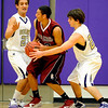 Boulder's Jared Kane (left) and Ethan Baker (right) block in Sand Creek's Danny Smith (middle) during their basketball game Boulder High School in Boulder, Colorado December 17, 2009.  CAMERA/Mark Leffingwell