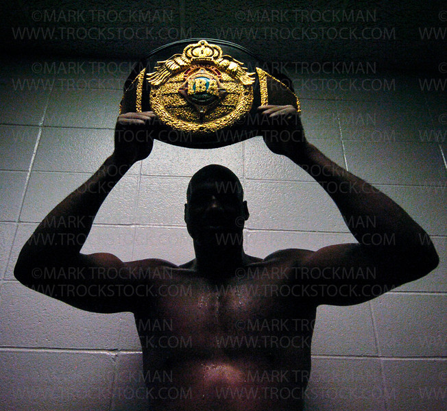 Photo by Mark Trockman<br /> <br /> Travis Walker holds the IBA championship belt in his dressing room following his bout Friday at Target Center in Minneapolis.