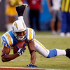 San Diego Chargers wide receiver Malcom Floyd cradles the ball as he pulls in a  20-yard pass reception against the Denver Broncos during the first quarter of an NFL football game Monday, Oct. 19, 2009 in San Diego. (AP Photo/Lenny Ignelzi)