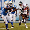 Denver Broncos' Eddie Royal pushes away San Diego Chargers' Paul Oliver while returning a kickoff 93-yards for a touchdown during the first quarter of an NFL football game Monday, Oct. 19, 2009 in San Diego. (AP Photo/Denis Poroy)