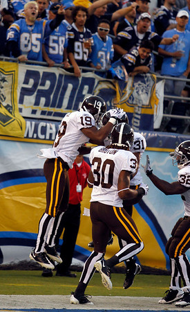 Denver Broncos'  Eddie Royal and teammates celebrate after Royal returned a kick off 93-yards for a touchdown against the San Diego Chargers during the first quarter of an NFL football game Monday, Oct. 19, 2009 in San Diego. (AP Photo/Denis Poroy)