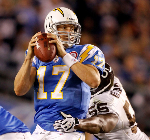 San Diego Chargers quarterback Philip Rivers is wrapped up and sacked by Denver Broncos linebacker D.J. Williams during the fourth quarter of the NFL football game Monday, Oct. 19, 2009 in San Diego. Rivers fumbled and Williams recovered the ball. The Broncos won 34-23 over the Chargers. (AP Photo/Denis Poroy)