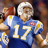 San Diego Chargers quarterback Philip Rivers losses the ball while being sacked during the fourth quarter of the Chargers 34-23 loss to the Denver Broncos in an NFL football game Monday, Oct. 19, 2009 in San Diego. The Broncos recovered.  (AP Photo/Denis Poroy)