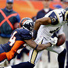 Denver Broncos cornerback Champ Bailey (24) knocks the ball from the hands of St. Louis Rams wide receiver Brandon Gibson (11) during the first half of an NFL football game Sunday, Nov. 28, 2010, in Denver. (AP Photo/Joe Mahoney)