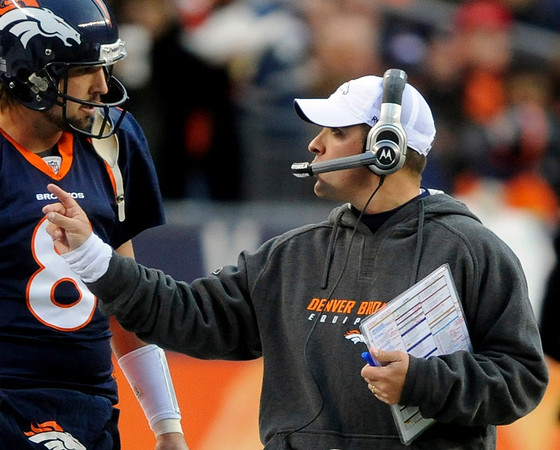 Denver Broncos head coach Josh McDaniels, right, talks with quarterback Kyle Orton (8) during the second quarter of an NFL football game against the St. Louis Rams, Sunday, Nov. 28, 2010, in Denver. (AP Photo/Chris Schneider)