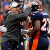Denver Broncos head coach Josh McDaniels, left, congratulates Knowshon Moreno (27) after Moreno scored a touchdown against the St. Louis Rams during an NFL football game on Sunday, Nov. 28, 2010, in Denver. (AP Photo/Jack Dempsey)