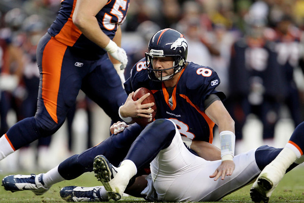Denver Broncos quarterback Kyle Orton (8)is sacked by the St. Louis Rams during the second quarter of an NFL football game Sunday, Nov. 28, 2010, in Denver. (AP Photo/Joe Mahoney)