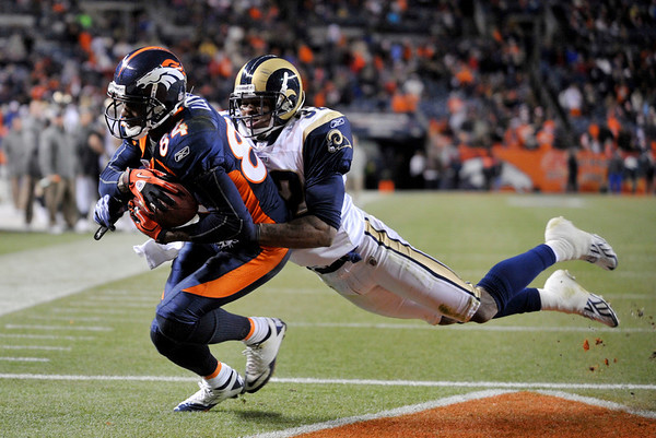 Denver Broncos wide receiver Brandon Lloyd (84) catches a touchdown pass St. Louis Rams cornerback Bradley Fletcher (32) against  during the second half of an NFL football game Sunday, Nov. 28, 2010, in Denver. (AP Photo/Joe Mahoney)