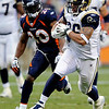 St. Louis Rams tight end Michael Hoomanawanui (86) runs for a touchdown against Denver Broncos safety Brian Dawkins (20) during the first half of an NFL football game Sunday, Nov. 28, 2010, in Denver. (AP Photo/Chris Schneider)