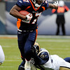 Denver Broncos running back Knowshon Moreno (27) slips out of the hands of St. Louis Rams safety Darian Stewart on Sunday, Nov. 28, 2010, in Denver. (AP Photo/Jack Dempsey)