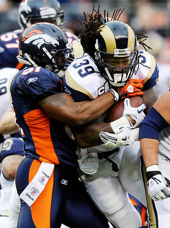 St. Louis Rams running back Steven Jackson (39) is tackled by Denver Broncos linebacker Joe Mays (51) during the first half of an NFL football game Sunday, Nov. 28, 2010, in Denver. (AP Photo/Chris Schneider)