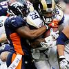 St. Louis Rams running back Steven Jackson (39) is tackled by Denver Broncos linebacker Joe Mays (51) during the first half of an NFL football game Sunday, Nov. 28, 2010, in Denver. (AP Photo/Chris Schneider)