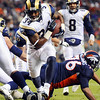St. Louis Rams running back Kenneth Darby (34) scores a touchdown against the Denver Broncos during the third quarter of an NFL football game Sunday, Nov. 28, 2010, in Denver. (AP Photo/Chris Schneider)