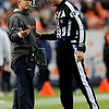 Denver Broncos head coach Josh McDaniels, left, talks with referee Bill Leavy (127) during the second half of an NFL football game against the St. Louis Rams, Sunday, Nov. 28, 2010, in Denver. (AP Photo/Chris Schneider)