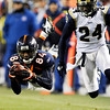 Denver Broncos wide receiver Brandon Lloyd (84) tries to make a catch against the St. Louis Rams cornerback Ronald Bartell (24) during the second half of an NFL football game Sunday, Nov. 28, 2010, in Denver. Lloyd dropped the pass and the Broncos lost 36-33. (AP Photo/Chris Schneider)