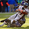 Denver Broncos wide receiver Eddie Royal, center, is stopped by Baltimore Ravens linebacker Prescott Burgess, bottom, and linebacker Tavares Gooden, upper right, during the third quarter of an NFL football game, Sunday, Nov. 1, 2009, in Baltimore. Baltimore won 30-7. (AP Photo/Gail Burton)