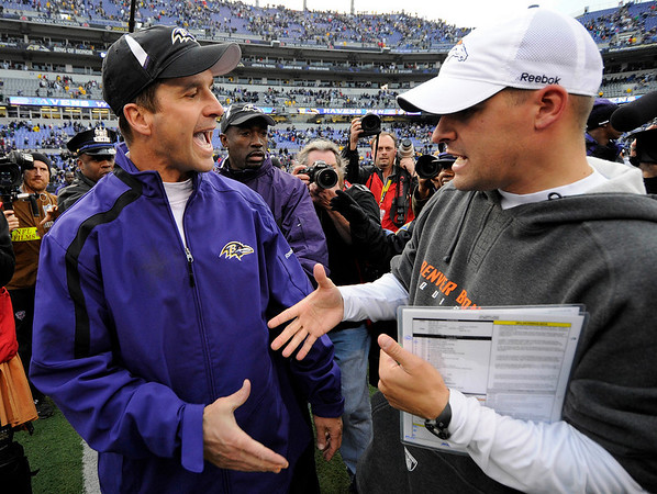 Baltimore Ravens head coach John Harbaugh, left, shakes hands with Denver Broncos head coach Josh McDaniels after an NFL football game, Sunday, Nov. 1, 2009, in Baltimore. Baltimore 30-7. (AP Photo/Nick Wass)
