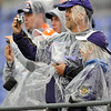 Baltimore Ravens fans wear plastic rain covers as they watch their team warm up in the rain before the NFL football game against the Denver Broncos, Sunday, Nov. 1, 2009 in Baltimore. (AP Photo/Gail Burton)