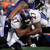 Denver Broncos running back Knowshon Moreno (27) scores a touchdown under pressure from Baltimore Ravens linebacker Ray Lewis, top, during the third quarter of an NFL football game, Sunday, Nov. 1, 2009, in Baltimore. (AP Photo/Nick Wass)