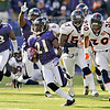 Baltimore Ravens cornerback Lardarius Webb (21) carries the ball for a touchdown during the third quarter of an NFL football game against the Denver Broncos, Sunday, Nov. 1, 2009, in Baltimore. Baltimore won 30-7. (AP Photo/Gail Burton)