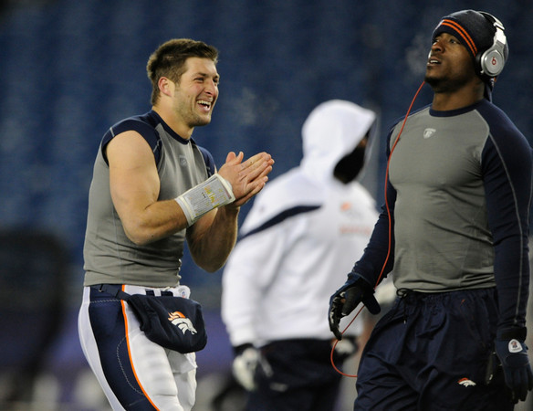Denver Broncos quarterback Tim Tebow (15) and Denver Broncos running back Willis McGahee (23) warmimg up before the Denver Broncos vs New England Patriots AFC Division Playoff game.  Saturday January 14, 2012 at Gillette Stadium.  AAron  Ontiveroz, The Denver Post