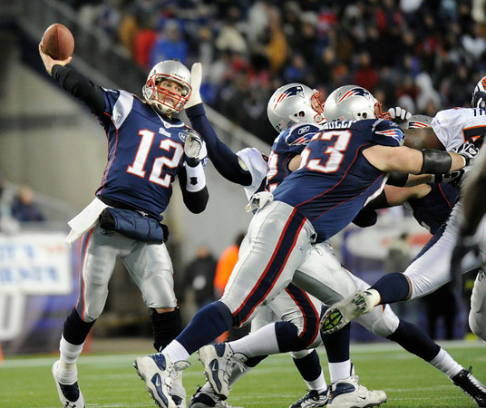 New England Patriots quarterback Tom Brady (12) throws during the third quarter. Denver Broncos vs New England Patriots AFC Division Playoff game.  Saturday January 14, 2012 at Gillette Stadium.  Hyoung Chang, The Denver Post