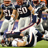 Denver Broncos quarterback Tim Tebow (15) is sacked and driven into the turf by New England Patriots defensive end Shaun Ellis (94) during the third quarter. Denver Broncos vs New England Patriots AFC Division Playoff game.  Saturday January 14, 2012 at Gillette Stadium.  John Leyba, The Denver Post