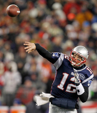 New England Patriots quarterback Tom Brady throws a pass during the first half of an NFL divisional playoff football game against the Denver Broncos Saturday, Jan. 14, 2012, in Foxborough, Mass. (AP Photo/Elise Amendola)