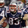 New England Patriots wide receiver Wes Welker celebrates after scoring on a seven yard touchdown pass during the first half of an NFL divisional playoff football game against the Denver Broncos Saturday, Jan. 14, 2012, in Foxborough, Mass. (AP Photo/Charles Krupa)