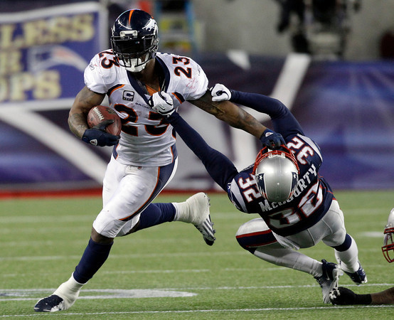New England Patriots cornerback Devin McCourty (32) tries to bring down Denver Broncos running back Willis McGahee (23) during the second half of an NFL divisional playoff football game Saturday, Jan. 14, 2012, in Foxborough, Mass. (AP Photo/Stephan Savoia)