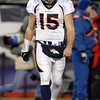 Denver Broncos quarterback Tim Tebow walks off the field during the second half of an NFL divisional playoff football game against the New England Patriots Saturday, Jan. 14, 2012, in Foxborough, Mass. (AP Photo/Elise Amendola)