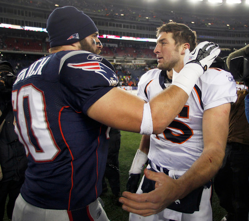 New England Patriots outside linebacker Rob Ninkovich, left, chats with Denver Broncos quarterback Tim Tebow (15) following an NFL divisional playoff football game Saturday, Jan. 14, 2012, in Foxborough, Mass. The Patriots defeated the Broncos 45-10. (AP Photo/Charles Krupa)