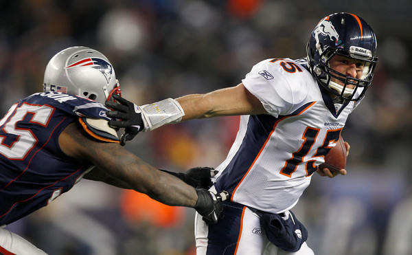Denver Broncos quarterback Tim Tebow (15) escapes from New England Patriots defensive end Mark Anderson (95) during the second half of an NFL divisional playoff football game Saturday, Jan. 14, 2012, in Foxborough, Mass. (AP Photo/Charles Krupa)