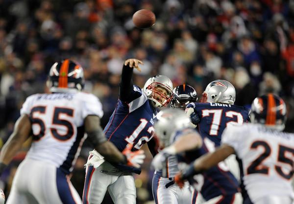 New England Patriots quarterback Tom Brady (12) drops back to throw during the second quarter. Denver Broncos vs New England Patriots AFC Division Playoff game.  Saturday January 14, 2012 at Gillette Stadium.  AAron  Ontiveroz, The Denver Post