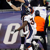 New England Patriots tight end Rob Gronkowski (87) catches a 28-yard pass against Denver Broncos defensive back Rafael Bush (36) during the second half of an NFL divisional playoff football game Saturday, Jan. 14, 2012, in Foxborough, Mass. (AP Photo/Elise Amendola)
