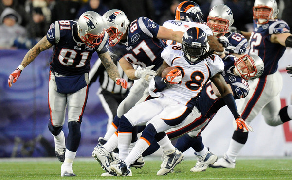 Denver Broncos wide receiver Demaryius Thomas (88) is brought down by a host of New England Patriots in the first quarter. Denver Broncos vs New England Patriots AFC Division Playoff game.  Saturday January 14, 2012 at Gillette Stadium.  John Leyba, The Denver Post