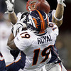 New England Patriots free safety Patrick Chung, rear, breaks up a pass intended for Denver Broncos wide receiver Eddie Royal during the second half of an NFL divisional playoff football game Saturday, Jan. 14, 2012, in Foxborough, Mass. (AP Photo/Stephan Savoia)