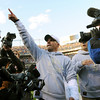 Denver Broncos coach Josh McDaniels salutes the crowd after the Broncos defeated the New England Patriots 20-17 in overtime in an NFL football game Sunday, Oct. 11, 2009, in Denver. (AP Photo/Chris Schneider)